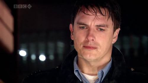 John barrowman as Captain Jack Harkness soaking from standing in the rain...