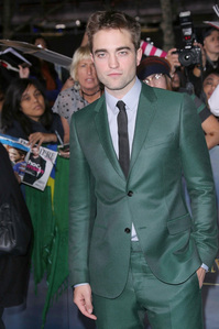 my gorgeous Robert,at the LA premiere of BD part 2 with his hand in his pocket<3