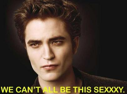my sexy Robert Pattinson,as Edward Cullen,with a black background behind him<3