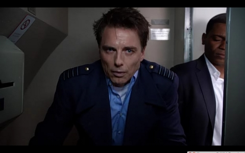 John barrowman as Captain Jack Harkness when he is poisoned on a plane in Miracle hari :'(