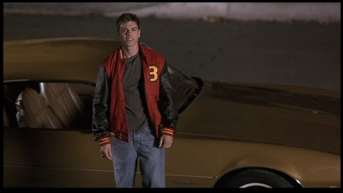 Matthew in front of his car in The Hot Chick. <333