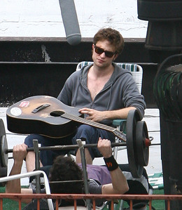 my handsome Robert,holding a guitar,which he can play.Play the gitar for me Rob,and sing me a song.<3
