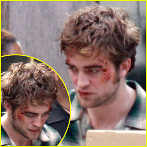 my Robert with a little blood on his face(while filming Remember Me)<3