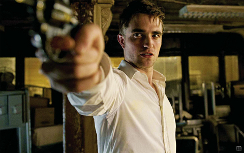 my Robert,in a scene from Cosmopolis,pointing a gun at someone.