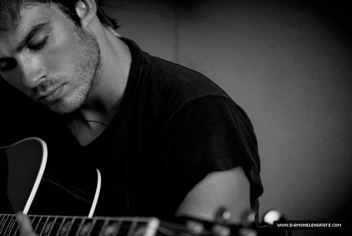 Ian Somerhalder with a guitar, though it's only part of one but clearly it's a guitar.
