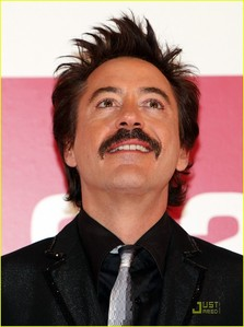 that stache is so funny XD beside of the tie all in black :))