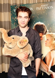 here is an adorable pic of my Robert holding a stuffed elephant,which he autographed for charity<3