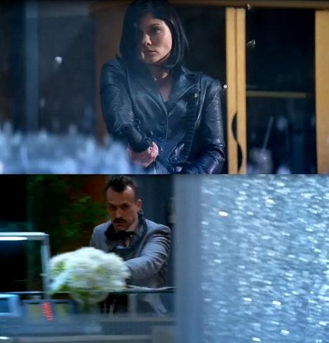 Rob & Jodi shooting a glass office into crumbs