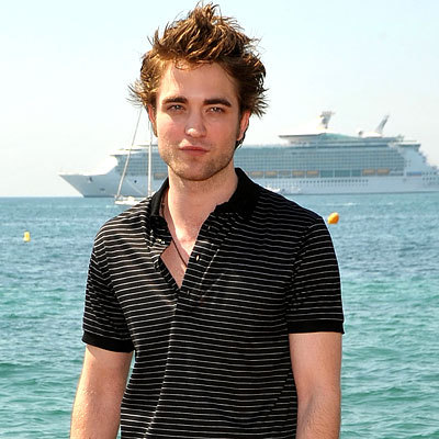 my Robert at Cannes a few years ago,with the French Riviera behind him.I would 愛 to go to France with Robert and do what the french do,especially french kiss<3