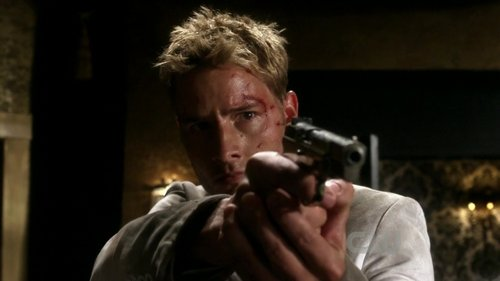 """Justin (as Oliver Queen) pointing at Victoria Roulette in Smallville, episode """"Roulette"""""""