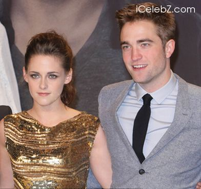 Here is a pic of my Robert and Kristen at the Berlin premiere for BD part 2.There is a website logo at 最佳, 返回页首 R corner.