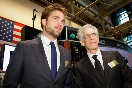 here is Rob at the NYSE with the American flag behind him<3