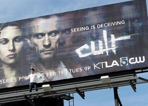 climbed on his billboard