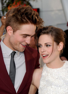 Robert with Kristen at Eclipse premiere.Wonder what he کہا to make her look shocked and surprised.Hmm,I wish I had vampire super hearing<3