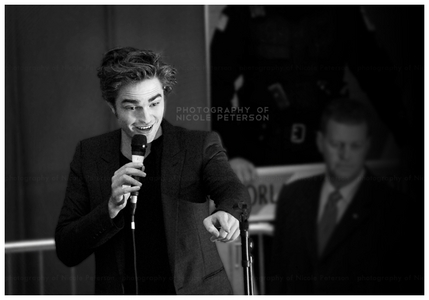my Robert pointing and talking to someone...me(i wish)