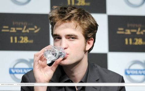 my Robert drinking a bottle of water.Oh those sexy lips(swoon).I'm kind of jealous of that water bottle<3