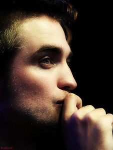 my gorgeous Robert touching his oh so kissable mouth<3