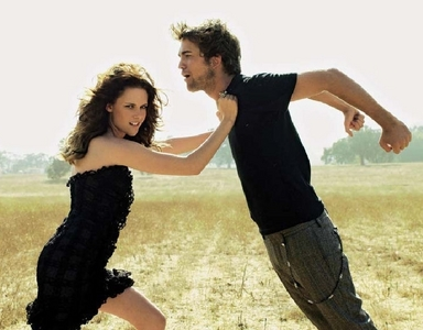 here's my Robert,with Kristen in a 2008 photoshoot in a weird stance<3