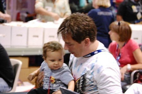 John Barrowman with a baby at a book signing :)