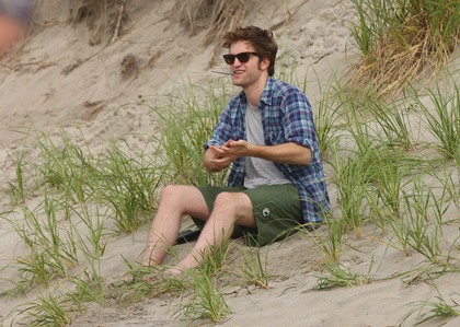 my Robert,in between takes on Remember Me,sitting in the sand.<3