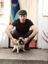 Hugh Laurie with a little dog