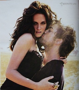 my Robert s'embrasser Kristen's cheek.Soooooooo in l'amour with this pic of them,such a sweet picture<3