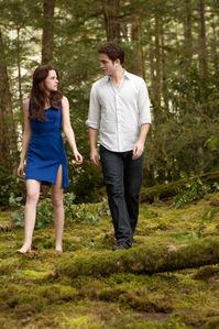 my Robert in BD 2,with Kristen Stewart,with green trees in the background.<3
