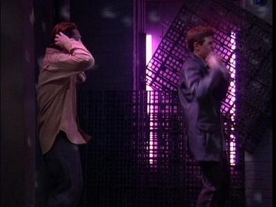 Matthew doing a little dance under a pink light. <333