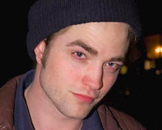 my Robert with red bags under his eyes.Even with the red bags under his eyes he is still sexy as hell!!!!!!!