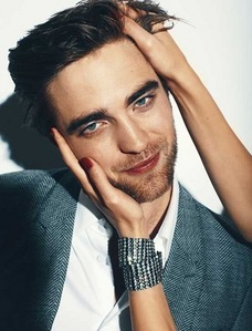 here is my Robert during a magazine photoshoot with someone holding his head(wish it was me)<3