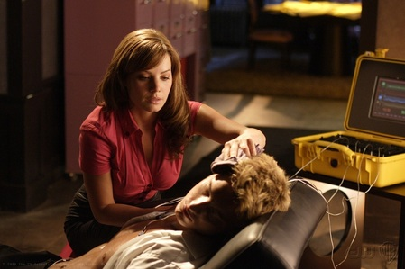 """Justin in a scene from """"Toxic""""; he got poisoned at a fundraiser and Lois plays his personal nurse (can we trade, Ms. Lane??)"""