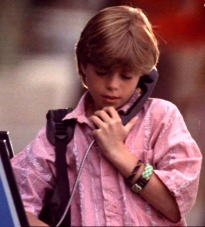 Little Matt using a pay phone. :)
