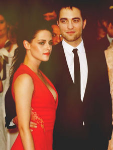 my Robert with Kristen in a red dress at Cannes.Kristen looks beautiful in the red dress.Love the dress and the guy she's with<3
