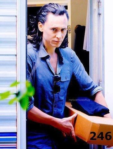 Tom Hiddleston <3 careing a box