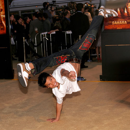 young Taylor doing a handstand,one-handed:)