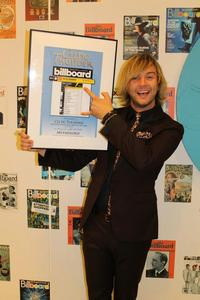my adorable baby boy receiving an award for being #1 on the world billboard charts! (His own album is on there)