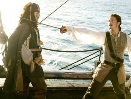 my 2nd fave Brit,Orlando Bloom with a sword from POTC.He is one sexy pirate<3