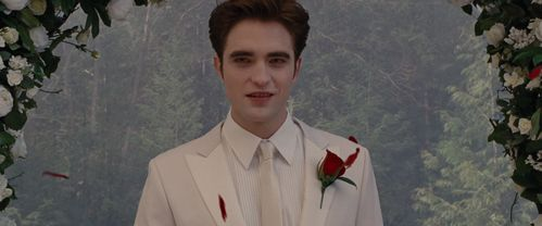 my gorgeous Angel Robert wearing all white in a scene from BD part 1.He belongs on superiore, in alto of a wedding cake.<3