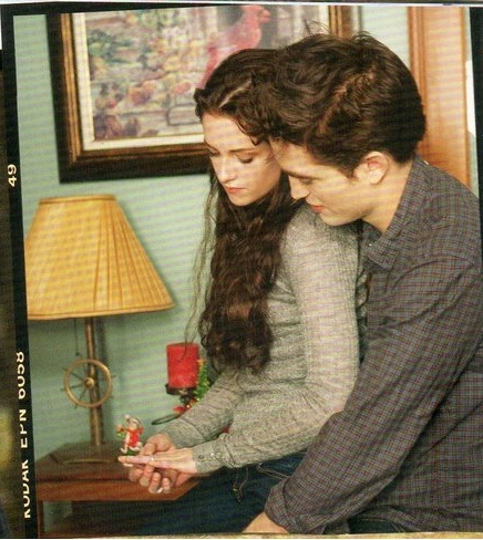 Kristen Stewart,as Bella sitting on my Robert's(as Edward) lap,in a scene from BD 2.I want to trade places with her<3
