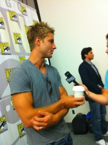 Justin holding a plastic coffee cup, Comic Con 2010