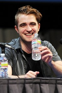 my handsome Robert holding a plastic water bottle at the 2011 Comic-Con,which took place in my hometown of San Diego,California.Don't forget the 4 R's...reduce,re-use,recycle and of course Robert...lol<3