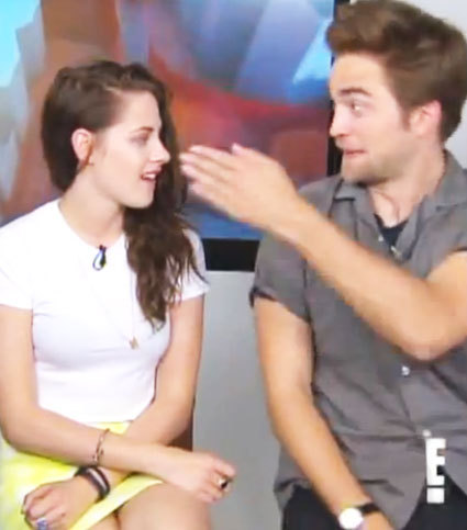 my Robert pretending to slap Kristen during an MTV interview from the 2012 Comic-Con.My Robert is only joking,he would never really hit a woman..he's a lover not a fighter<3