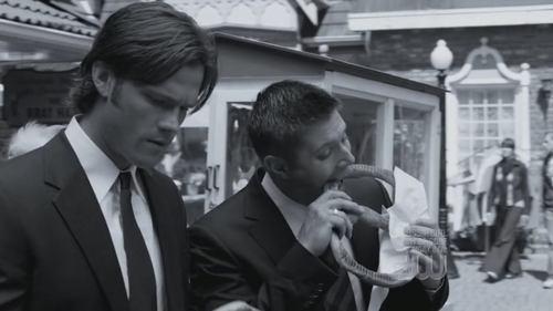 "Dean and Sam investigating at an ""Oktoberfest"" - and eating pretzels. Bon Appetit! LOL"