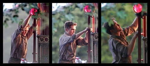 my Robert climbing over a cable car to reach the ladder,in a scene from Water for Elephants<3