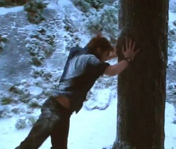 my baby Robert in a scene from Eclipse about to push down a tree<3