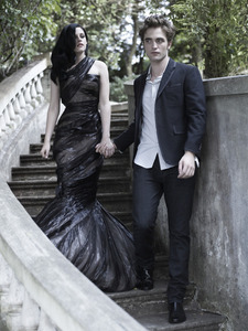 my baby,with Kristen Stewart,posing on the stairs for a photoshoot<3