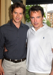 John Barrowman actually doesn't have a girlfriend/wife..He has a husband and hes PROUD! They've been togethar since 1993 :) They entered into a civil partnership on December 27, 2006 :)