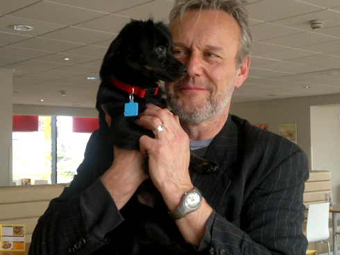 seldom Tony with beard. but a puppy is always there
