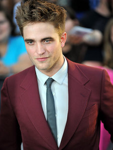 my gorgeous Robert in a red suit and black tie for the Eclipse premiere<3