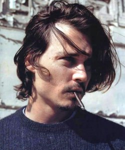 Johnny Depp with a cigarette hanging out of his mouth.